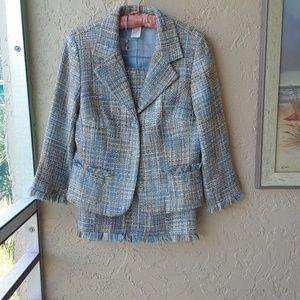 Suit in muted blue tweed tones.